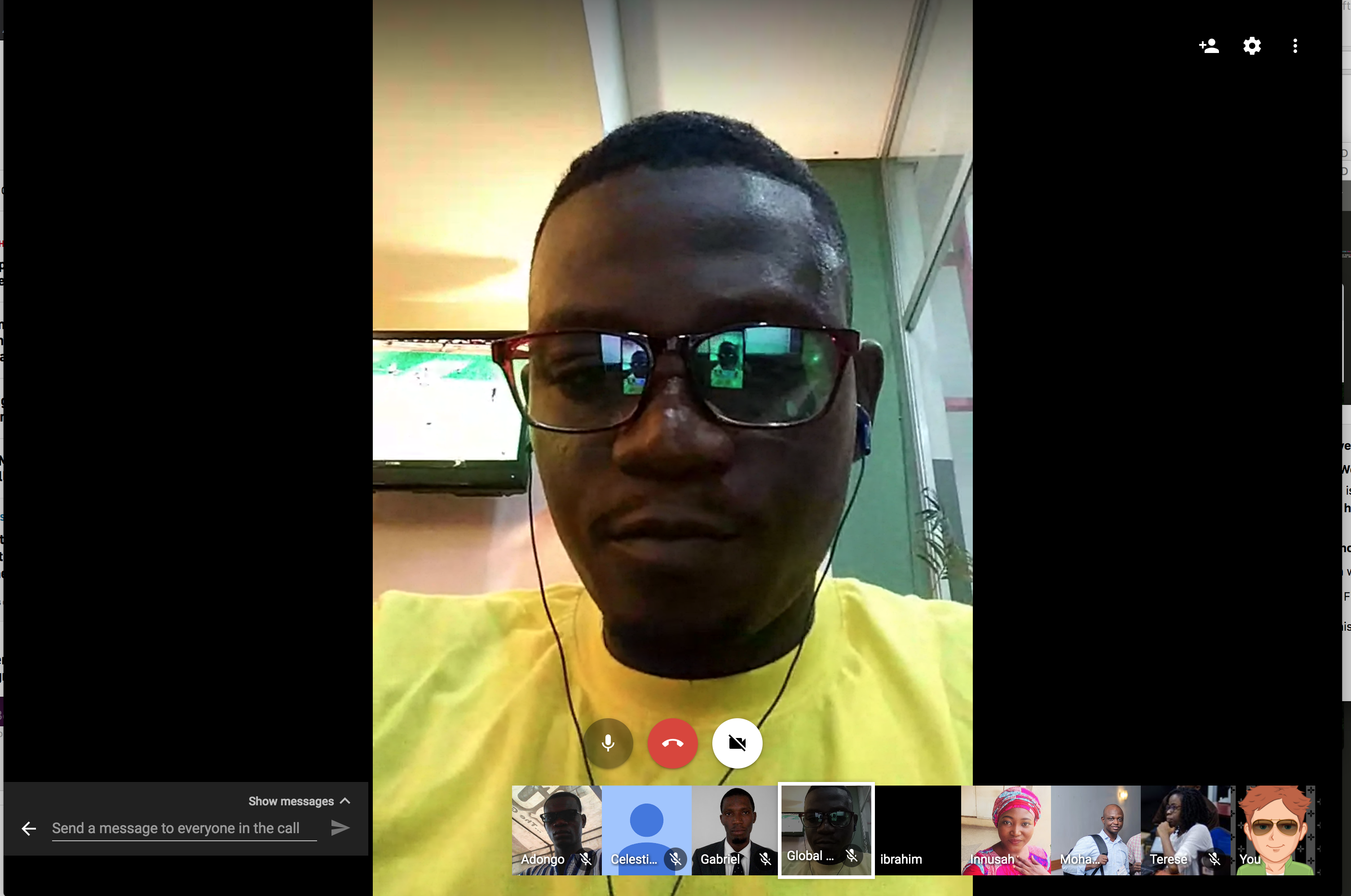 screenshot of a Google Hangout from the IndieWeb Meetup in Ghana. Sadik in the frame with eleven people as avatars